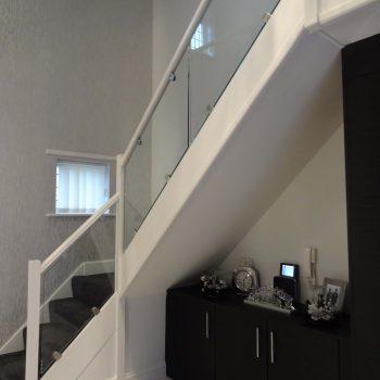 Staircase framed glass railings