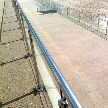 Beach promenade framed glass railings