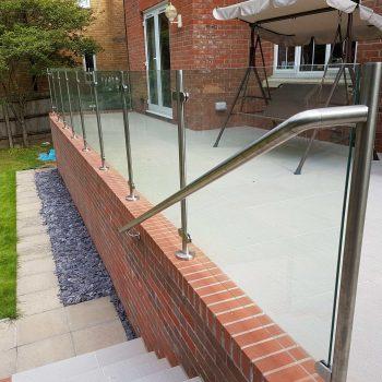 Frameless Glass Railings for raised garden patio and steps
