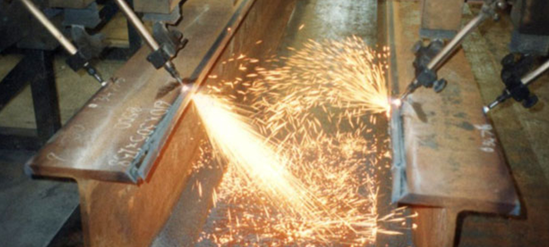 Steel beams cut and measured